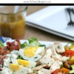 Cobb Salad Recipe layered with chicken , bacon, tomatoes, hardboiled eggs and avocado