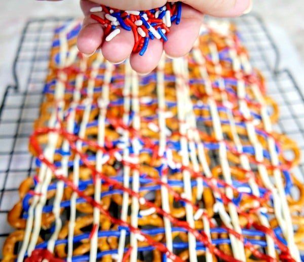 A close up of red white and blue pretzels with sprinkles