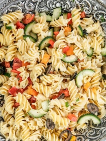 italian pasta salad with rotini pasta, cucumbers, tomatoes, red peppers and olives