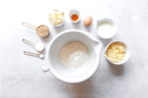 several ingredients in bowls and measuring cups for scones recipe