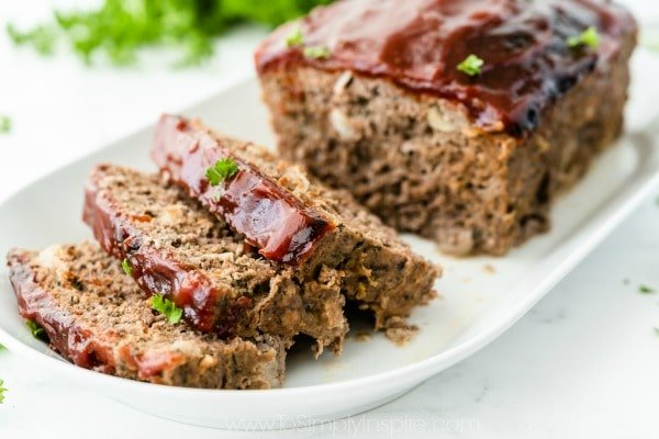 Classic Meatloaf with tomato glaze on a white plate
