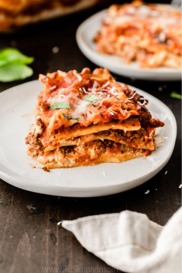 closeup slice of lasagna on a white plate
