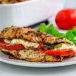 chicken breast stuffed with tomato slice, fresh mozzarella and fresh basil