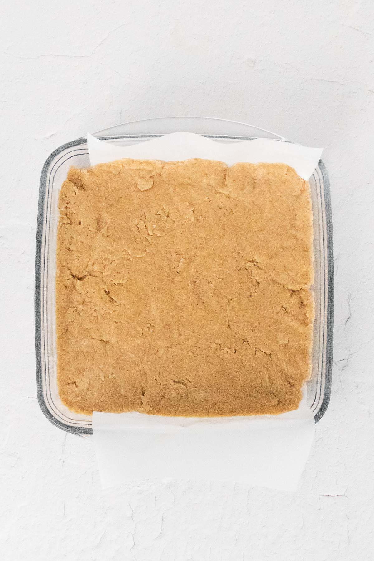 shortbread dough pressend into a square baking dish