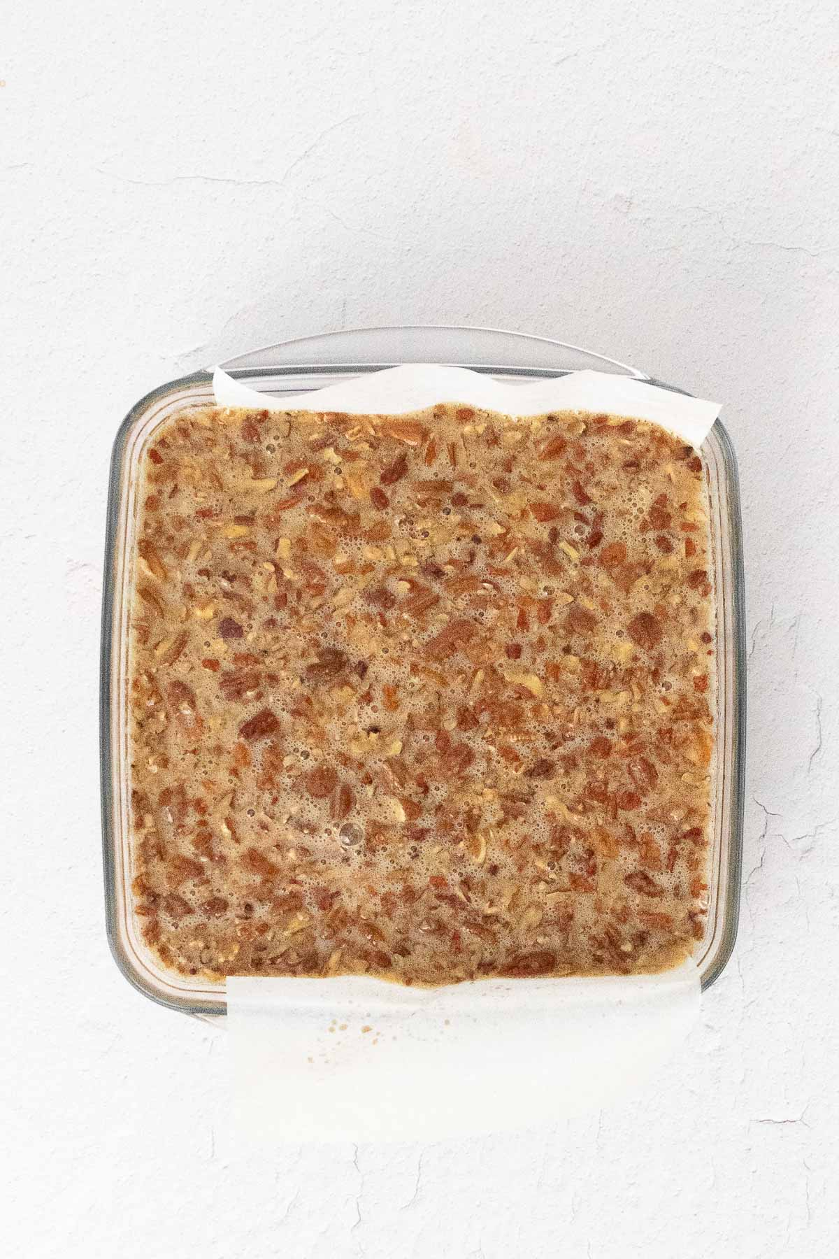 pecan pie bars ingredients in a square glass