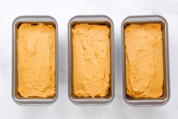 three loaf pan full of sweet potato bread batter