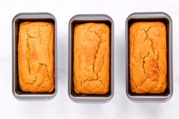 three loaves of sweet potato bread in pans