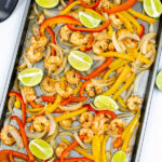 sheet pan shrimp fajitas on a baking sheet topped