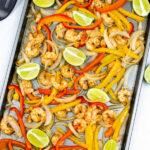 sheet pan shrimp fajitas on a baking sheet topped