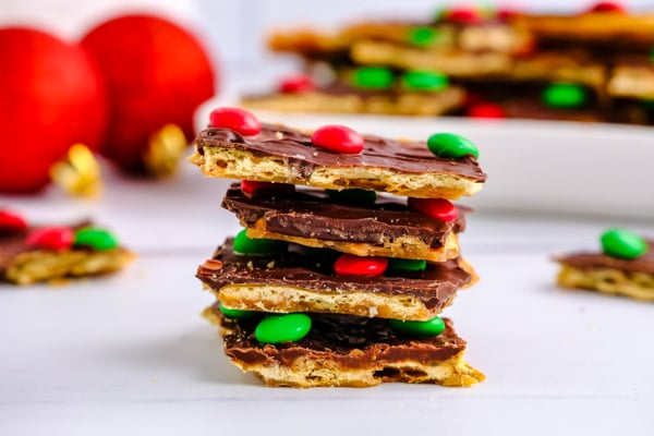 a stack of four pieces of saltine cracker toffee