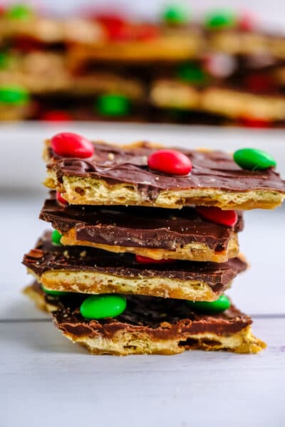 stack of four pieces of Christmas crack candy topped with m&m's on