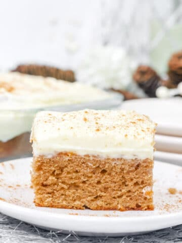 a slice of gingerbread cake with cream cheese frosting