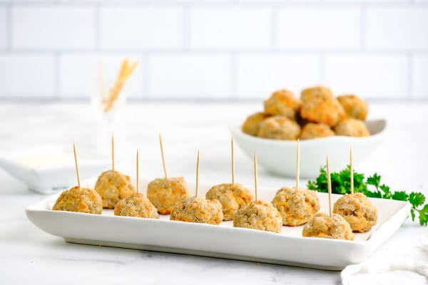 a tray full of sausage balls with toothpicks