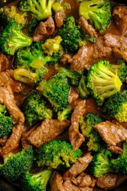 beef and broccoli in a cast iron skillet
