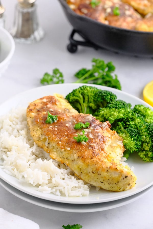 chicken breasts rice and broccoli on a white plate