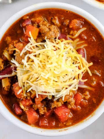 closeup of bowl of classic chili topped with cheese