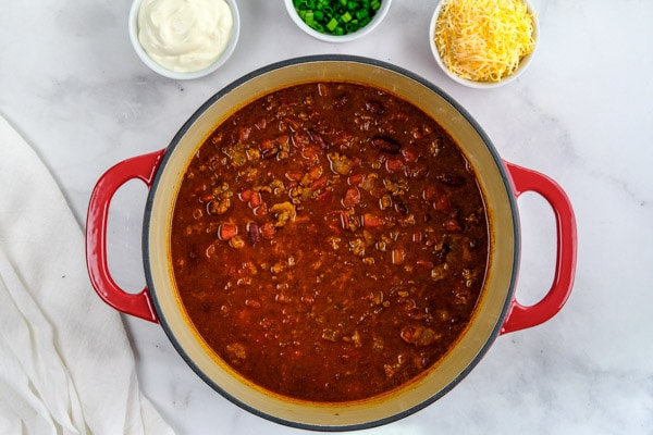 classic ground beef chili in a dutch oven