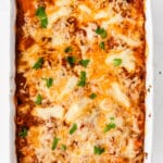 a white casserole dish with baked ziti