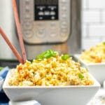 a white bowl with chicken fried rice with chop sticks in front of of instant pot