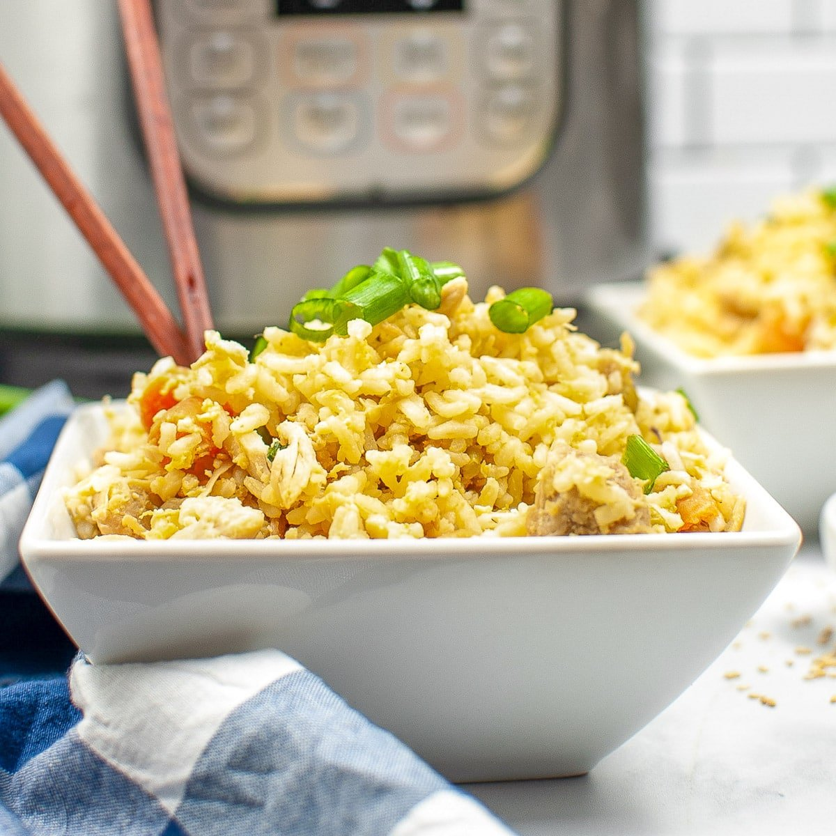chicken fried rice in a square white bowl