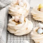 closeup of meringue nest filled with buttercream and cadbury eggs candy