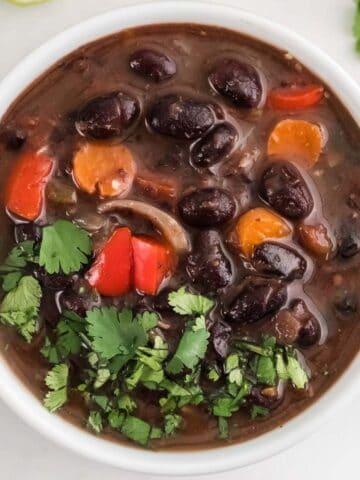 black bean soup in a white bowl