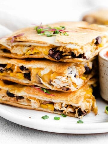 a stack of three quesadillas filled with chicken, black beans and cheese