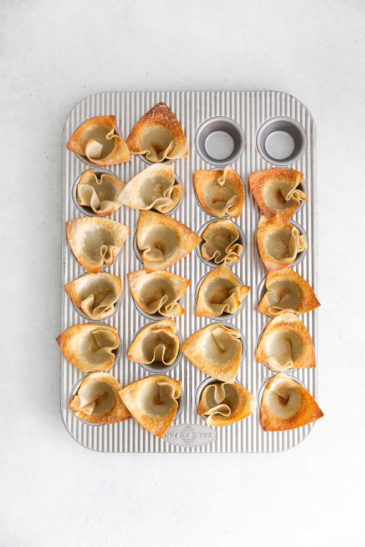 wonton wrappers in a mini muffin tin