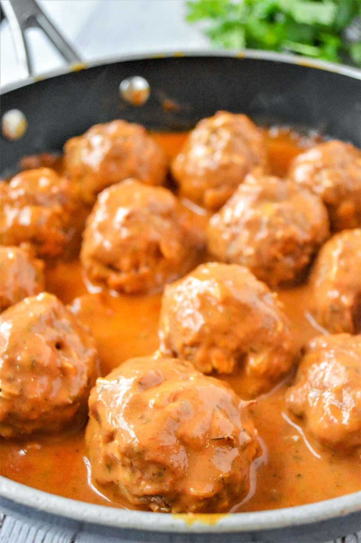 Tikka Masala Meatballs in a pan with sauce