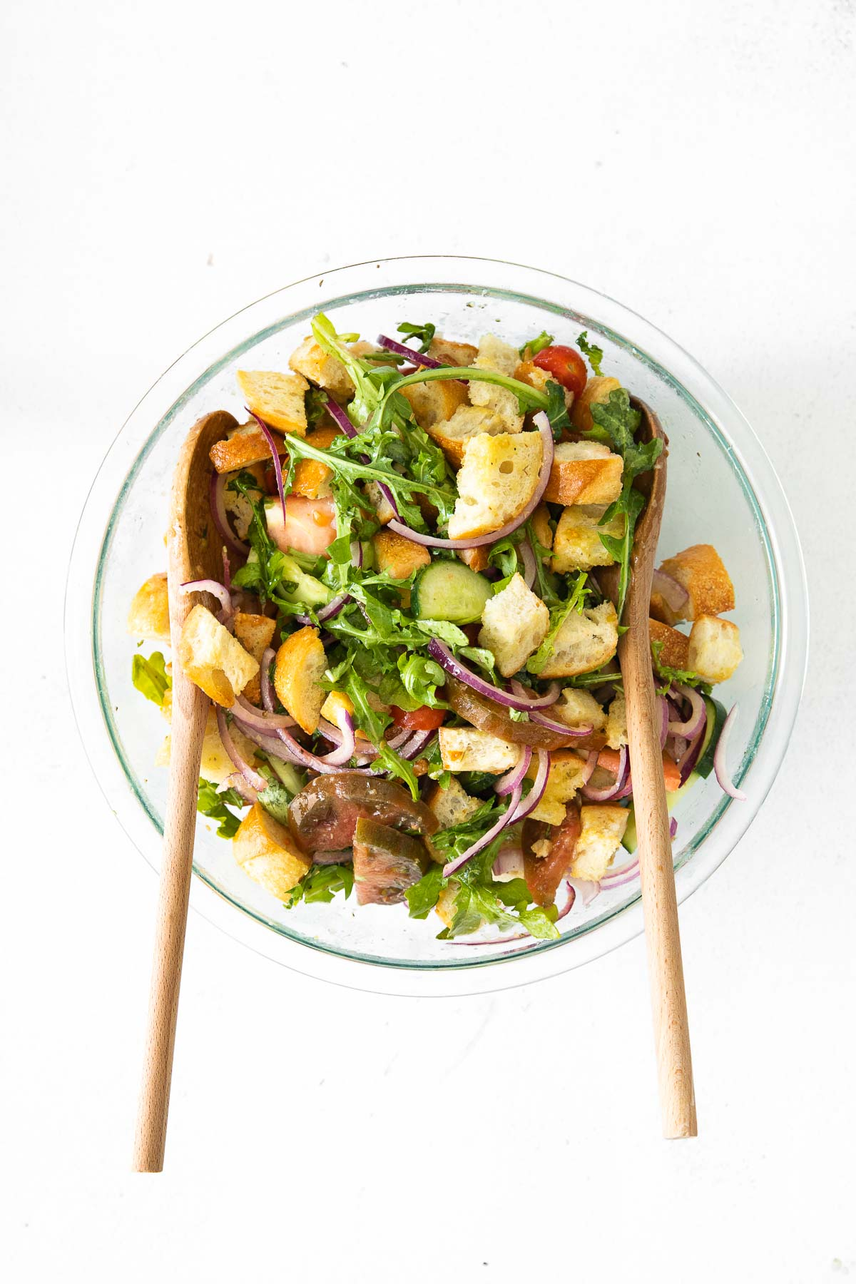 panzanella salad with bread cubes in a glass bowl