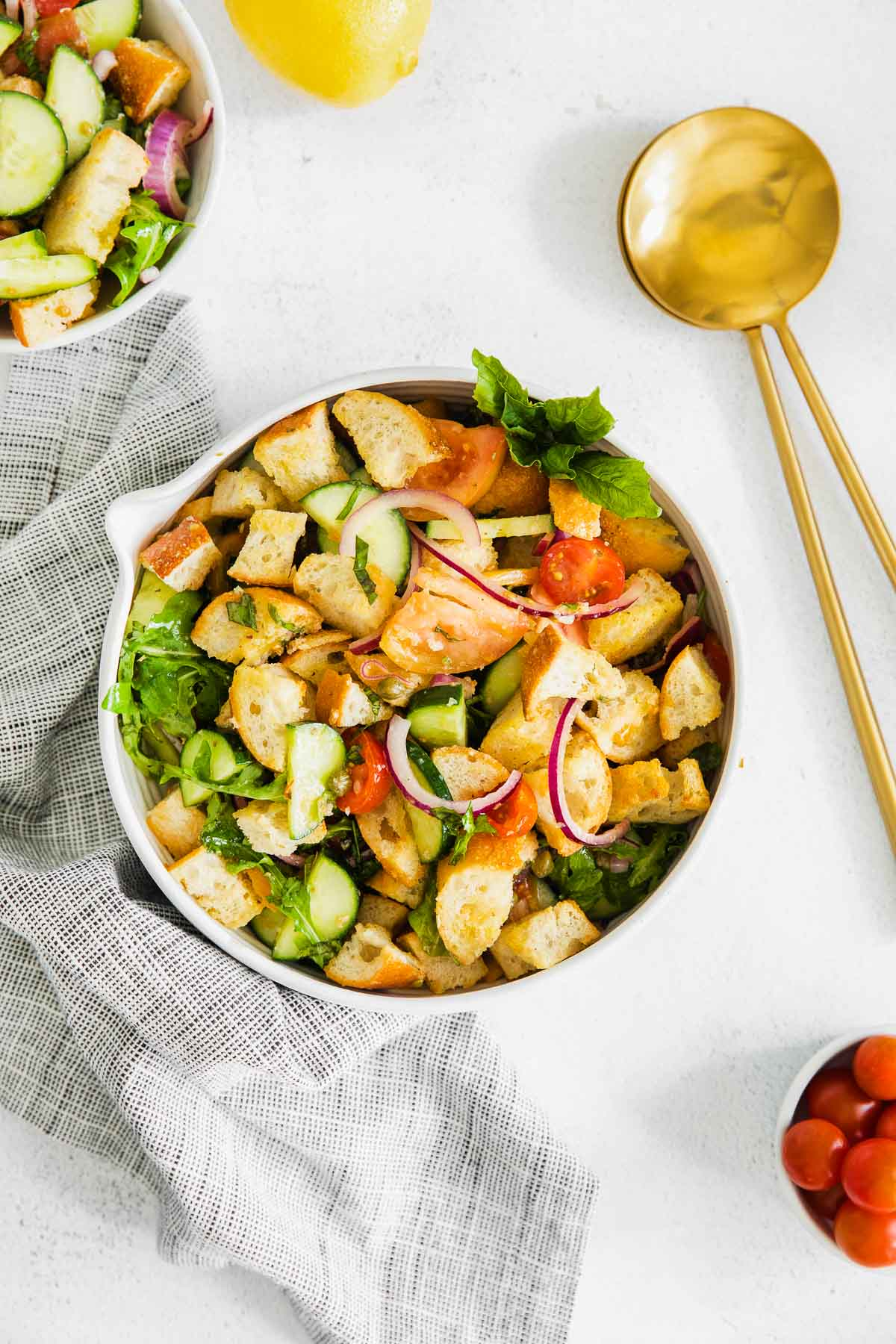 classic panzanella salad with bread cubes in a white bowl
