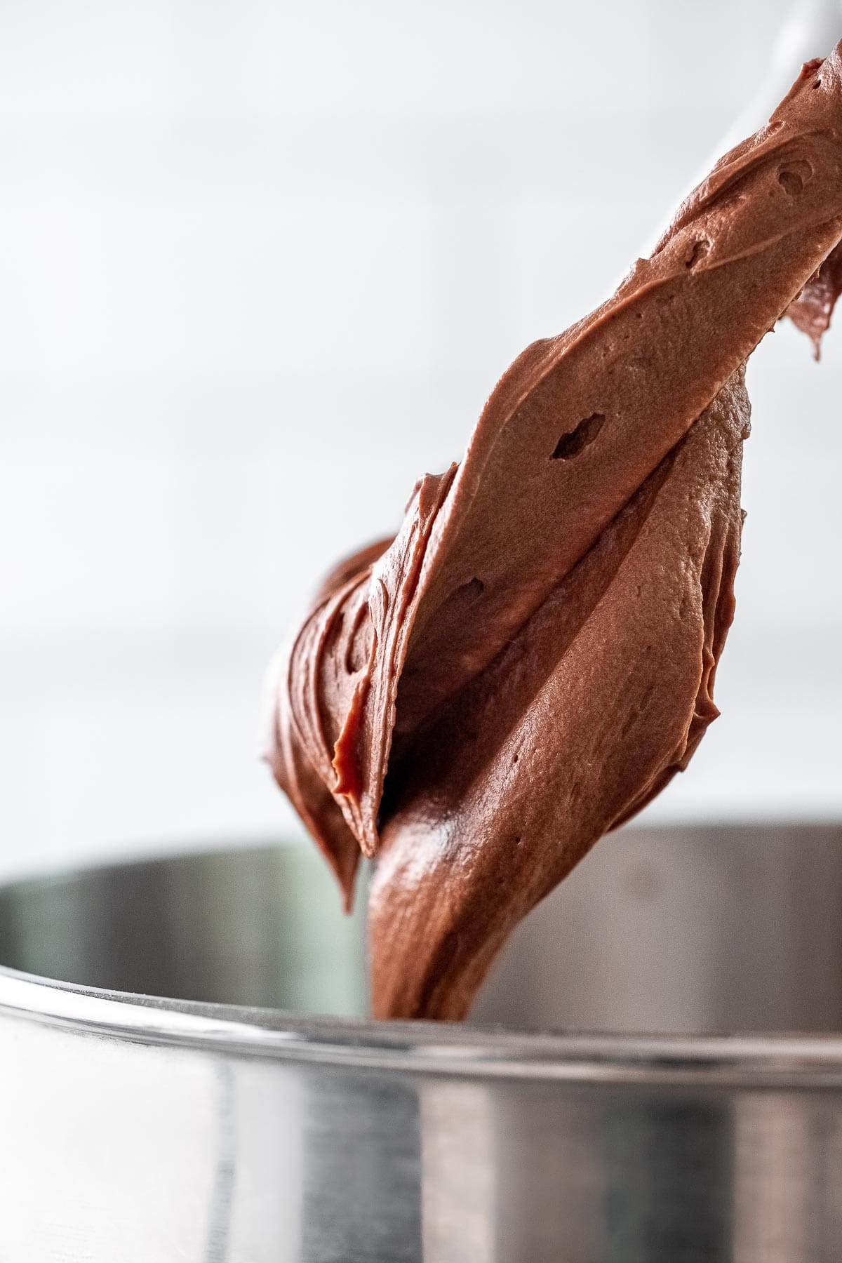 chocolate frosting on a blender paddle