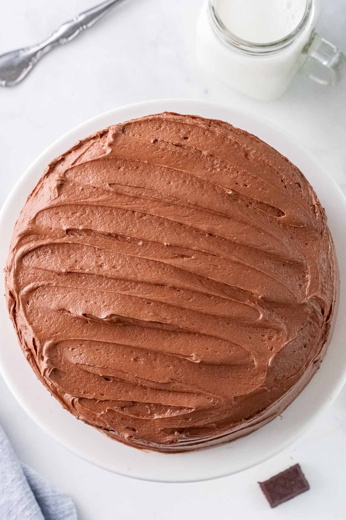 chocolate frosting on a round layer cake