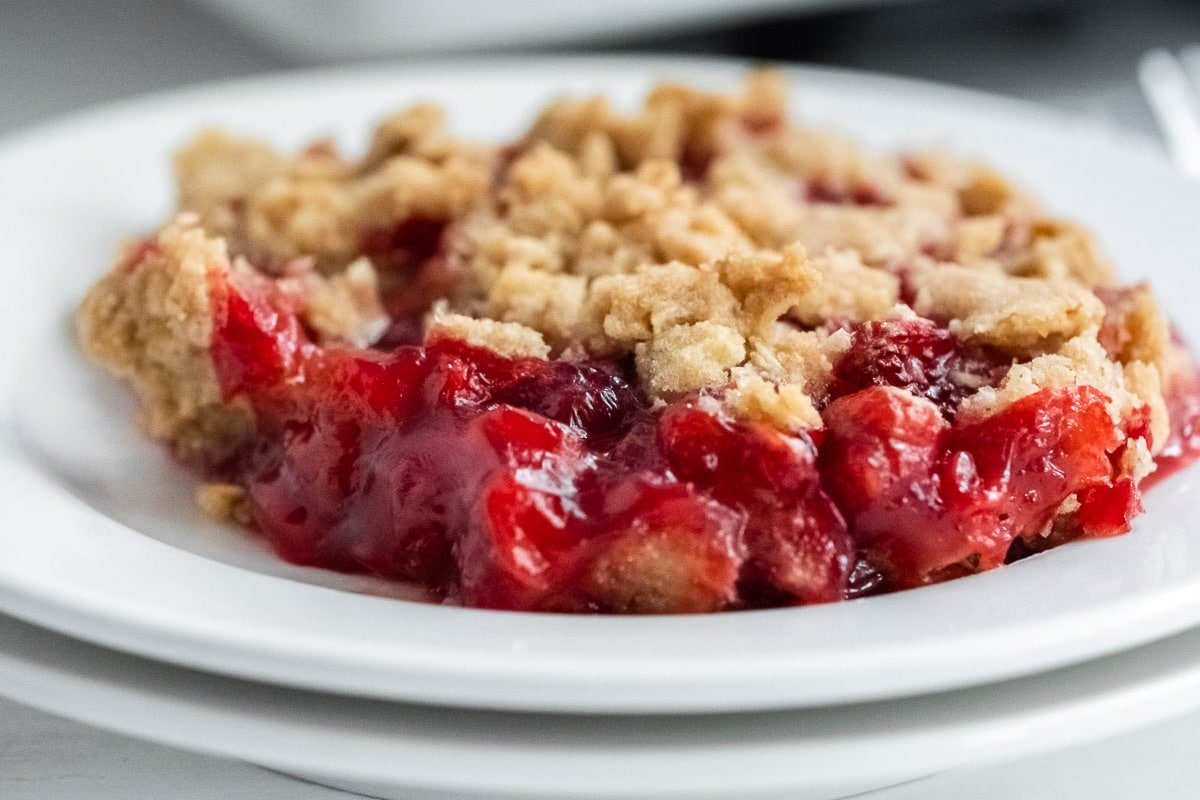 closeup of strawberry crumble on a white plate