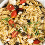 serving bowl with greek pasta salad with text overlay that reads Best Greek Pasta Salad