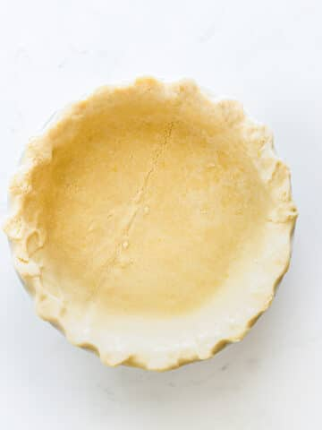 uncooked pie crust in a pie plate