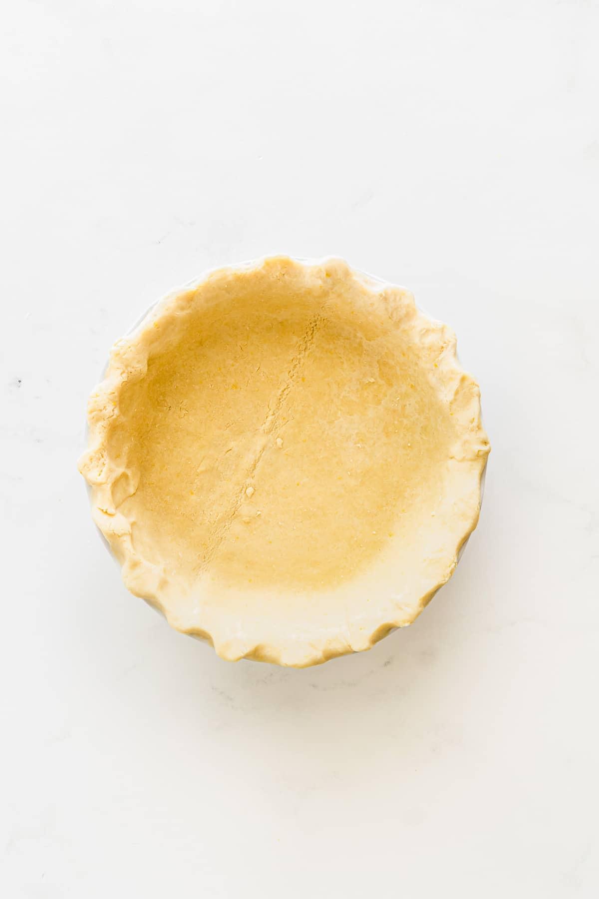 homemade pie crust in a pie dish