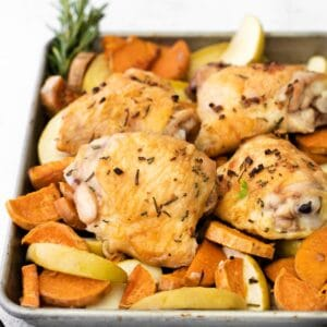 sheet pan with chicken thighs, sweet potato and apple slices