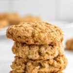 stack of four apple oatmeal cookies with text overlay that reads apple oatmeal cookies