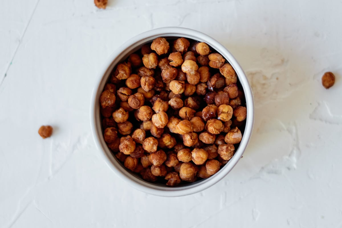 white bowl full of pumpkin spice roasted chickpeas
