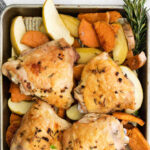 sheet pan chicken thighs with sweet potatoes and apples with text overlay