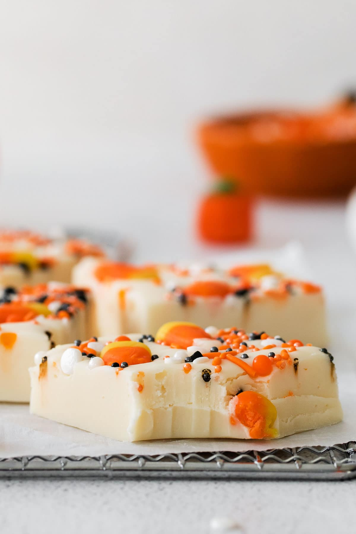 a slice of halloween decorated fudge with a bite taken out