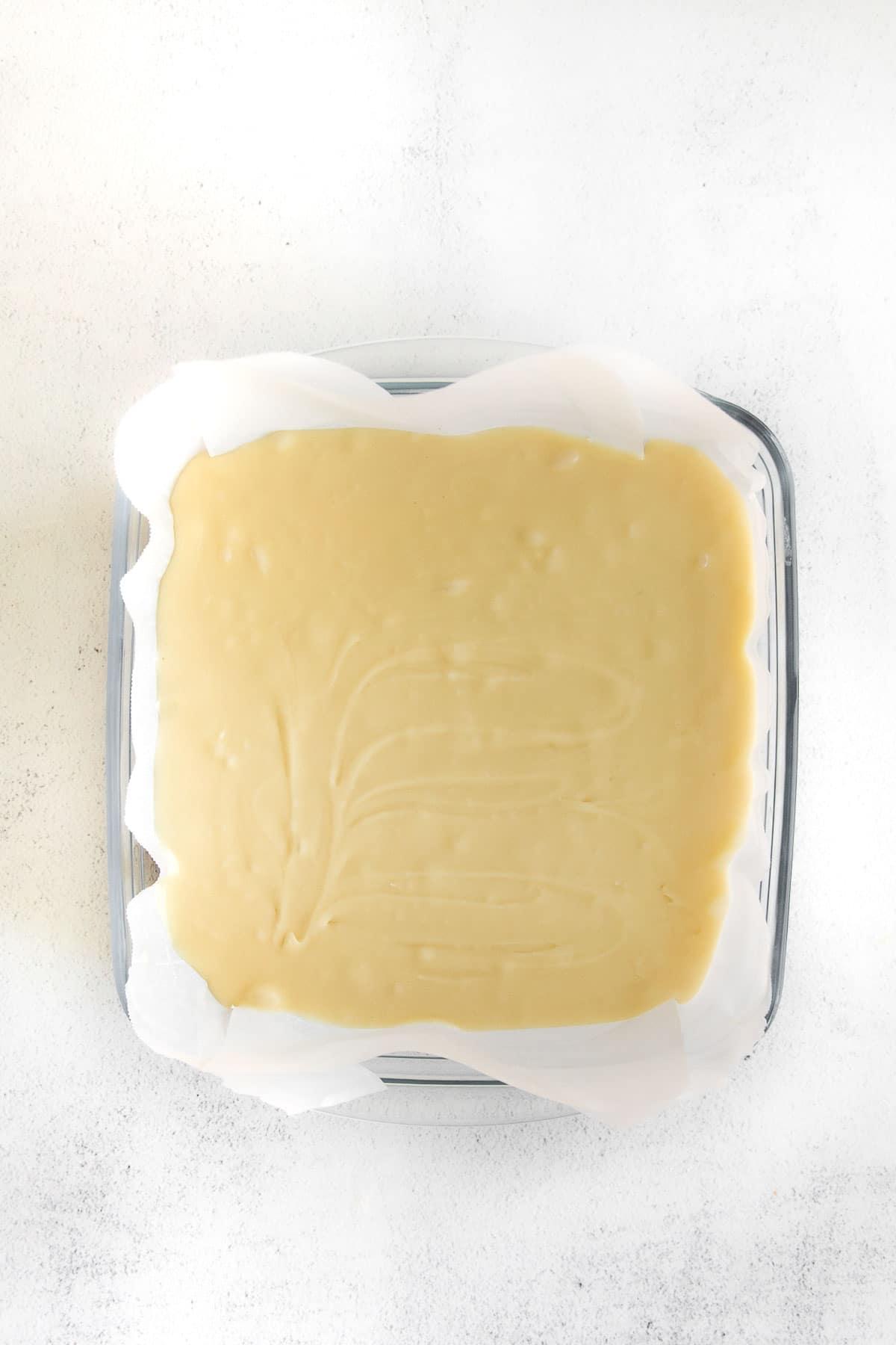 square glass baking dish with vanilla fudge mixture