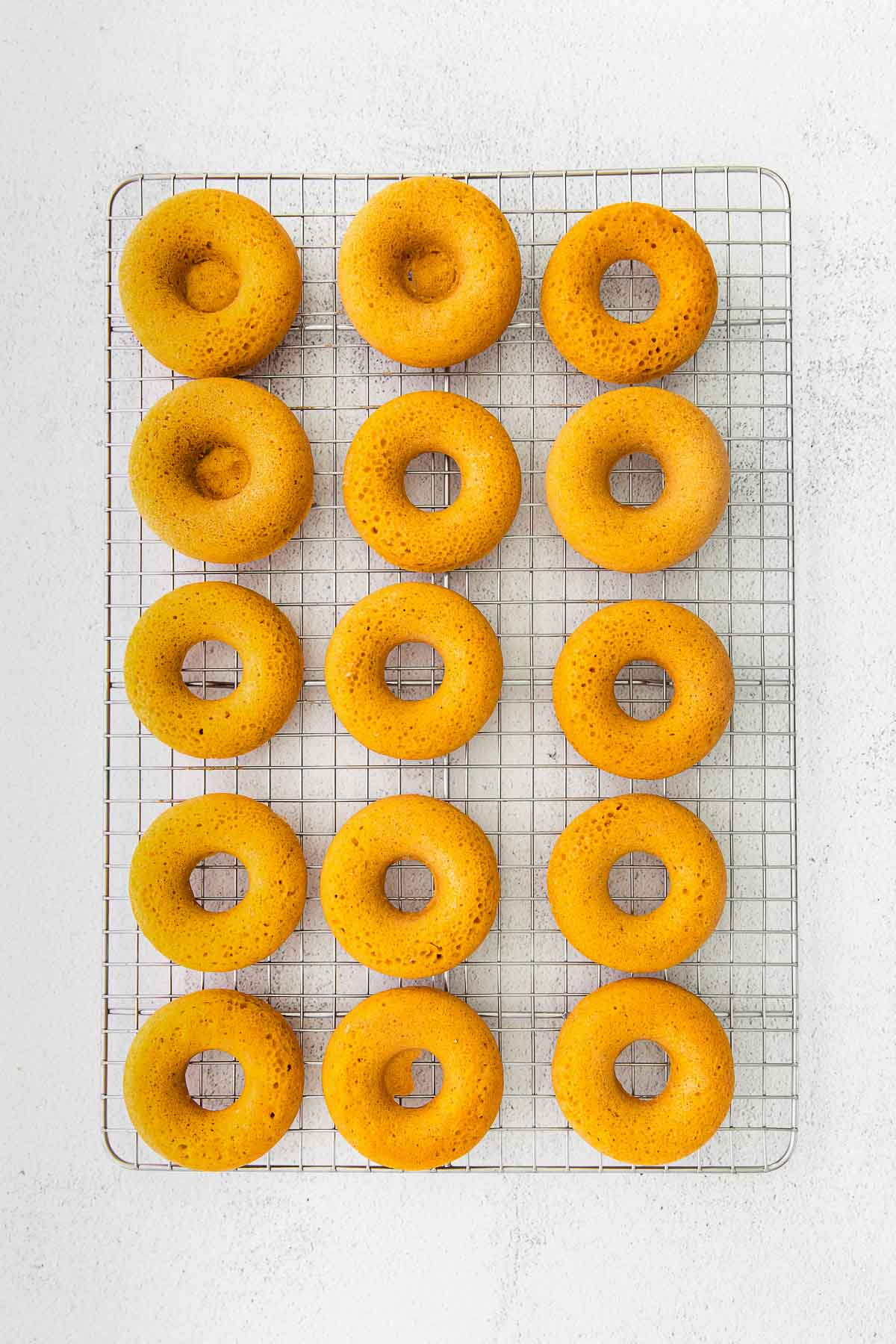 pumpkin donuts on a wire cooling rack