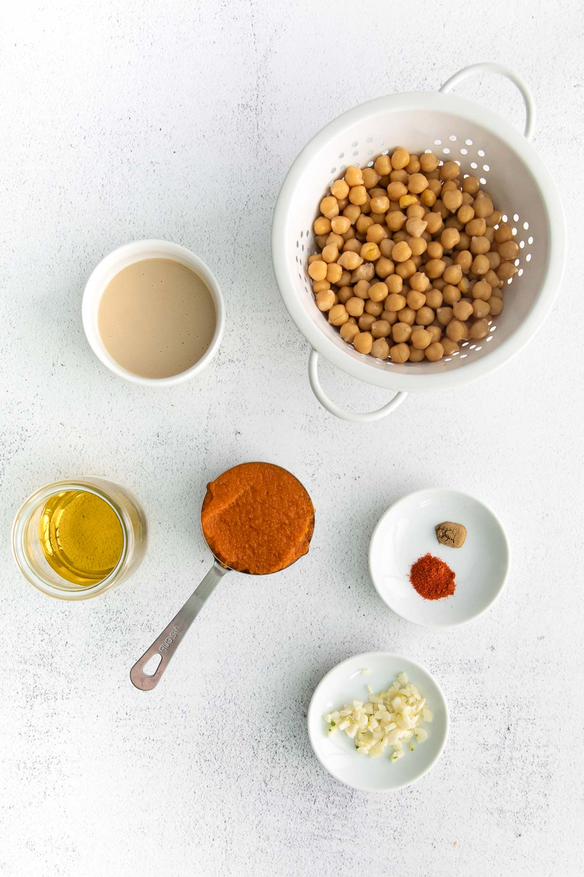 colander of chickpeas, and bowls of pumpkin puree, garlic, spices, tahini and olive oil