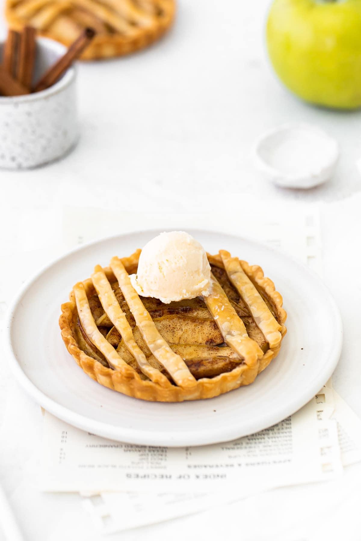 apple tart topped with vanilla ice cream